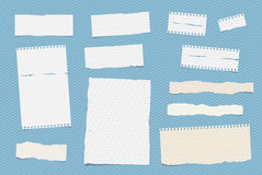 White ruled note, notebook, copybook paper sheets stuck on blue squared pattern.  Royalty Free Stock Photography