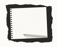 White ruled notebook paper sheet are on black ripped background with wooden pencil Stock Photo
