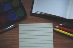 White Ruled Paper Beside Yellow Colored Pencil Royalty Free Stock Image