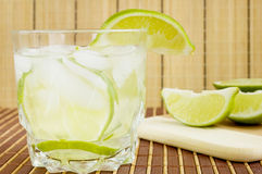 White Rum Cocktail. Caipirinha cocktail with limes ,white rum, sugar and ice Stock Image