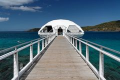 White Runway. White bridge and cottage in blue caribbean water Royalty Free Stock Images