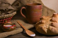 White rural bread on a wooden table Royalty Free Stock Image