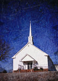 White rural church with grunge effects Royalty Free Stock Photo