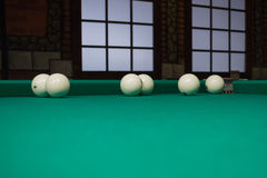 White russian billiards balls position on green game table cloth Royalty Free Stock Image