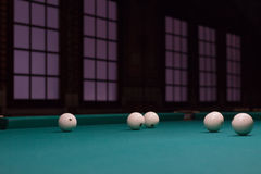White russian billiards balls position on green game table Royalty Free Stock Photo