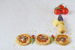 White rustic background with homemade biscuit in a form of pizza with chili,rosemary, cherry tomatoes, parmezan, cheese Stock Images