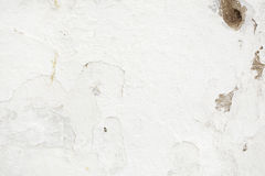 White Rustic Peeling Paint Texture. Closeup of a textured white wall taken in Mykonos, Greece. Rustic background texture has a variety of tones to it Royalty Free Stock Photos