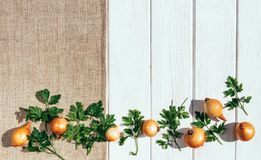 White rustic table, linen tablecloth and sliced vegetables. Organic food. Fresh sliced raw vegetables on the background of a wooden table and linen tablecloth Stock Photography