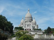 White sacero cathedral paris with greenery in the front royalty free stock photography
