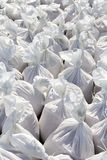White sacks filled with sand. Copy space Royalty Free Stock Photo