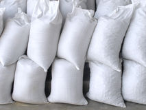 White sacks full with sand and rock Royalty Free Stock Photos