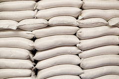 White sacks of rice in rice mill. Many white sacks of rice loaded in rice mill factory background image royalty free stock photos