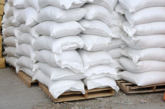 White sacks at storehouse Stock Photography