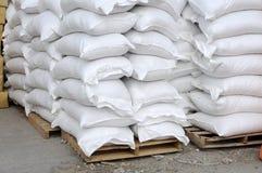 White sacks at storehouse Stock Photography