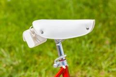 White saddle with saddlebag on red vintage 1970s folding bike Stock Image