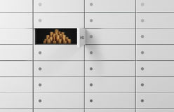 White safe deposit boxes in a bank. There are gold coins inside of a one box.  Stock Images