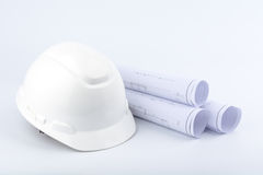 White safety helmet and paper Royalty Free Stock Image