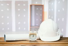 White safety helmet plastic, paper roll plan blueprint alarm clowhite safety helmet plastic, paper roll plan blueprint alarm clock. White safety helmet plastic royalty free stock photos