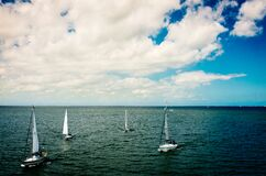 White Sail Boat on Body of Water Under Blue Cloudy Sky during Daytime Stock Photo