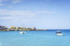White sail boats at Otranto coast, Italy Stock Photography