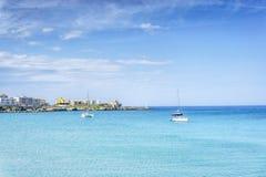 White sail boats at Otranto coast, Italy Stock Images