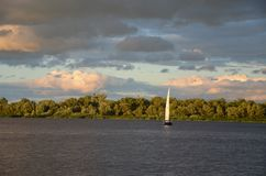 White sail and dramatic apocaliptic sky. In summer, sky with different colourings, Kiev, Ukraine stock photography