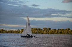 White sail and dramatic apocaliptic sky. In summer, sky with different colourings, Kiev, Ukraine royalty free stock photography