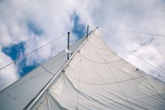 White sail in the wind on the boat, view from below Royalty Free Stock Images