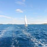 White sail yacht in blue Adriatic sea Stock Photos