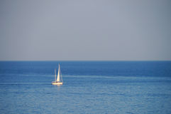 White sail yacht sailing in a calm sea,Mykonos. Royalty Free Stock Images