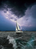 White sail.Storm sea.Black background. White yacht sail in the storm sea Stock Image