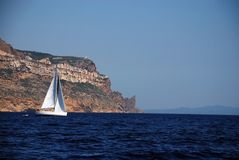 White sail yachts over rock in cassis France Royalty Free Stock Photo