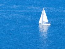 White Sailboat. ~ Sailing On Clear Blue Sea Royalty Free Stock Photos