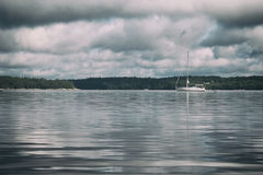 White Sailboat Across the Body of Water Under White and Gray Cloudy Sky Royalty Free Stock Photography