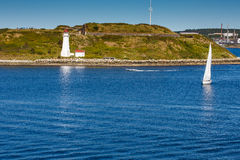 White Sailboat Approaching White Lighthouse Royalty Free Stock Photography