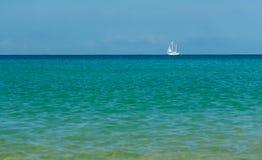 White sailboat on the azure sea Royalty Free Stock Image