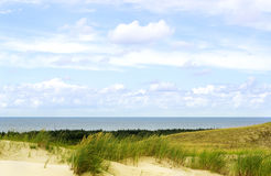 White Sailboat On The Background Of Dunes And Blue Sk Royalty Free Stock Photo