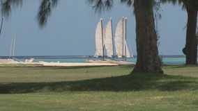White sailboat on the beach stock footage