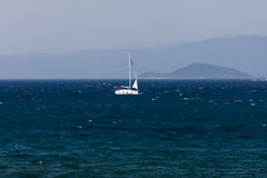 White sailboat on the blue aegean turkish sea Royalty Free Stock Image