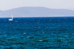 White sailboat on the blue aegean turkish sea Royalty Free Stock Photography