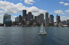 White Sailboat in Boston Harbor on a Summer Day stock photos