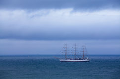 White Sailboat cloud and ocean Stock Image