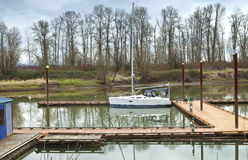 White sailboat moored in a river, Oregon. Royalty Free Stock Photography