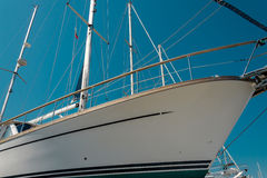 White sailboat in the port. Nose of white beautiful moored sailboat in the sea port Royalty Free Stock Photo