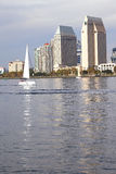A white sailboat and a San Diego skyline. Royalty Free Stock Photos