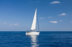 White sailboat in the sea Stock Photo