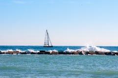 White sailboat at sea Royalty Free Stock Images