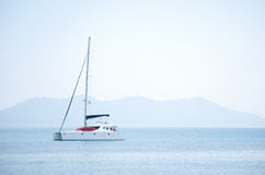 White sailboat in the sea Royalty Free Stock Image