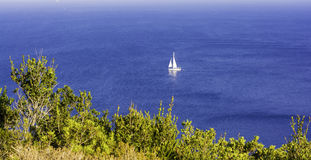 White sailboat in the sea. Summer season nature background Stock Photos
