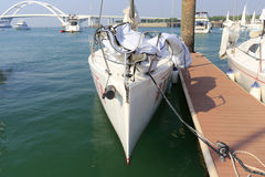White sailboat with sharp bow Stock Photo